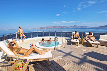 Couples leisure on luxury mega yacht charter