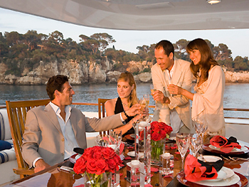 Couples ready for lunch on private yacht charter.